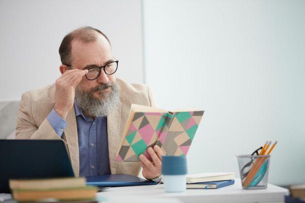 bearded-senior-teacher-at-desk-CKRZKEN.jpg
